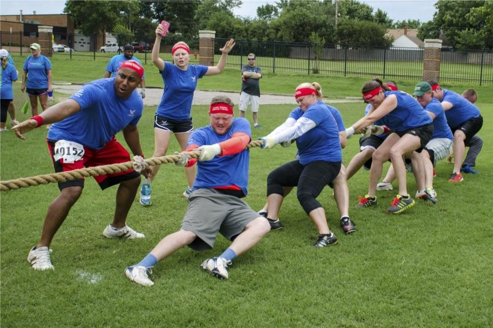 Photo -  American Energy Partners employees compete in the Corporate Challenge tug of war competition. Photo provided