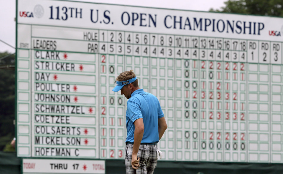 Photo - Ian Poulter, of England, reacts after missing a putt on the 18th hole during the first round of the U.S. Open golf tournament at Merion Golf Club, Thursday, June 13, 2013, in Ardmore, Pa. (AP Photo/Charlie Riedel)