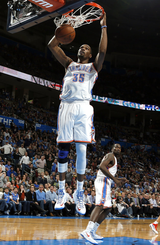 Photo - Oklahoma City's Kevin Durant (35) dunks during the NBA game between the Oklahoma City and the Utah Jazz and the Chesapeake Energy Arena, Friday,Nov. 30, 2012. Photo by Sarah Phipps, The Oklahoman