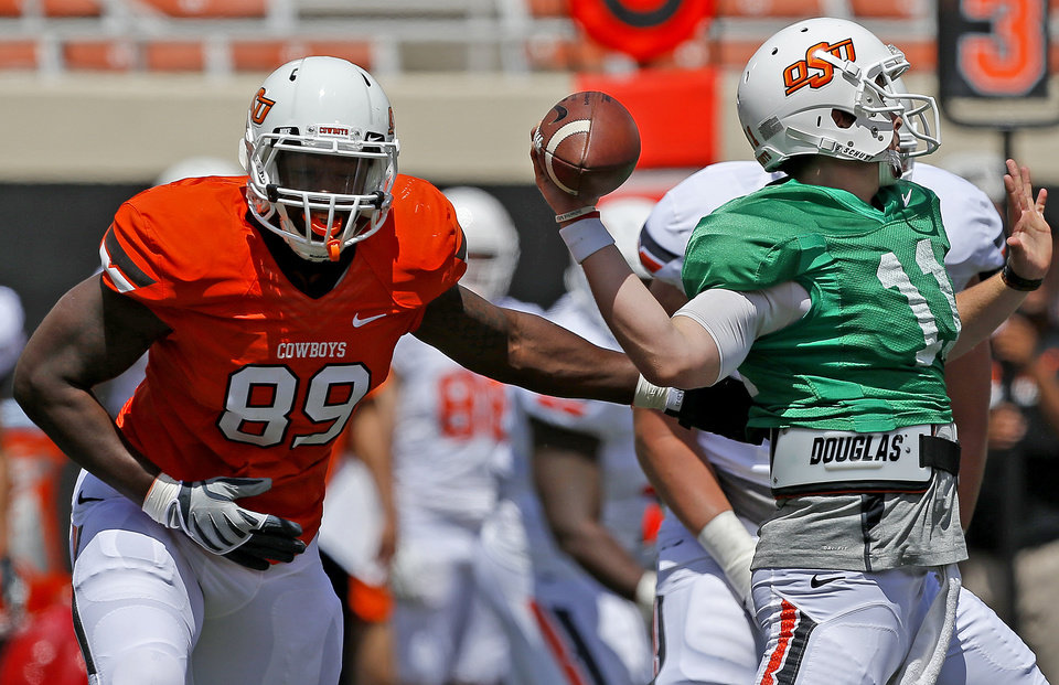 Oklahoma State's Sam Wren puts pressure on Wes Lunt during OSU's spring football game at Boone Pickens Stadium in Stillwater, Okla., Sat., April 20, 2013. Photo by Bryan Terry, The Oklahoman