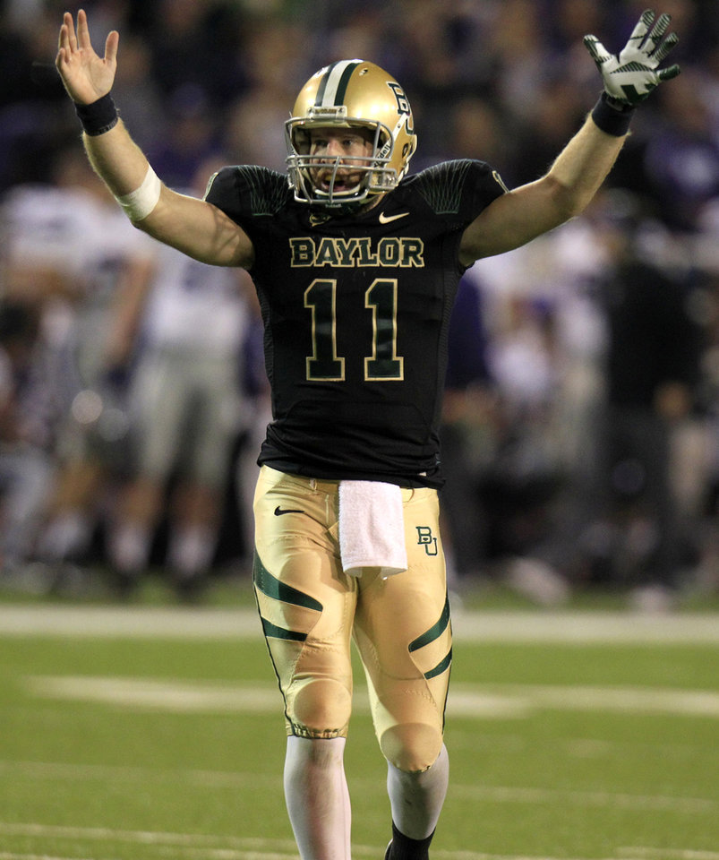 Photo -   Baylor quarterback Nick Florence (11) celebrates a touchdown during the third quarter for the NCAA college football game against Kansas State, Saturday, Nov. 17, 2012, in Waco Texas. (AP Photo/LM Otero)