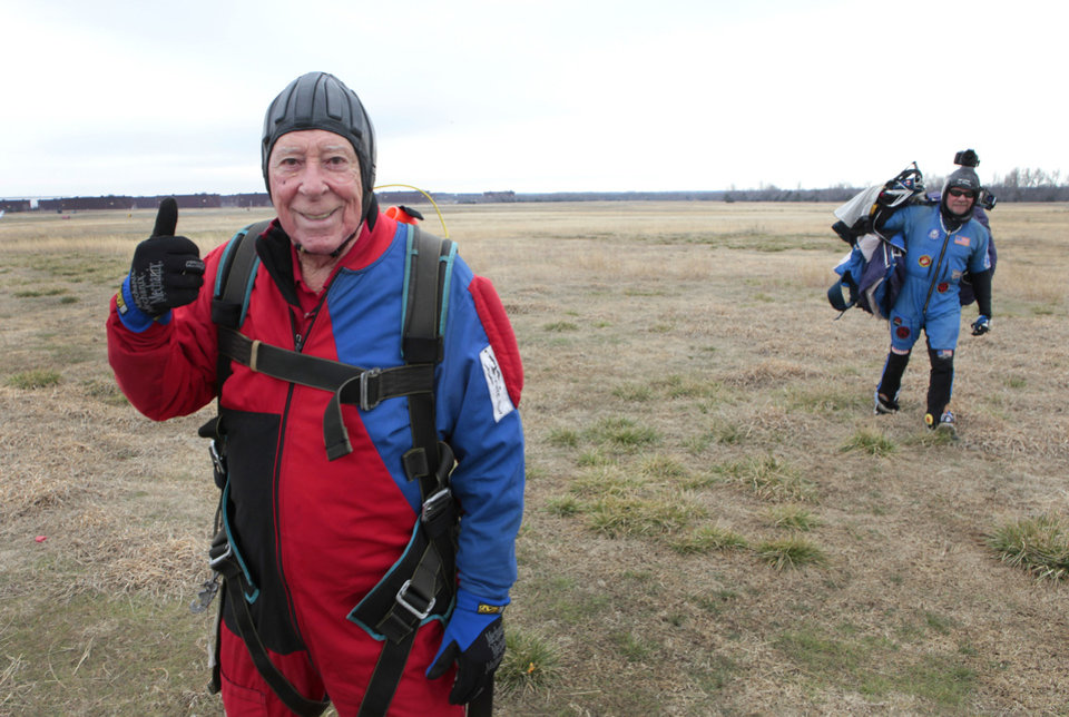 Ed Lamb, 88, gives the thumbs up after his successful parachute jump Saturday at Cushing Airport. Lamb was twice ordered to parachute from damaged aircraft during World War II and now, years later, he has fulfilled his dream to jump again. Photos By David McDaniel, The Oklahoman