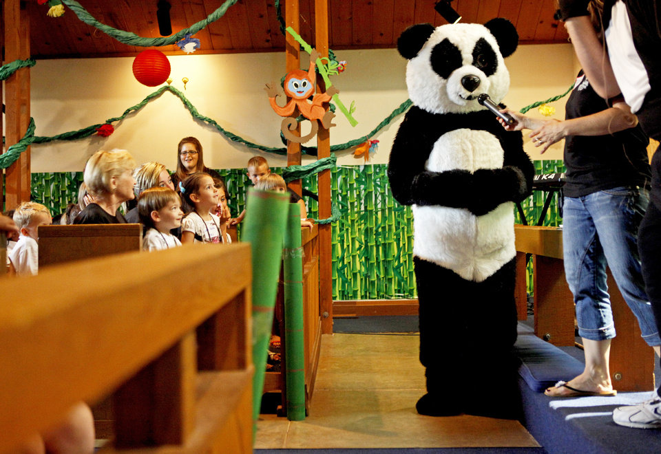 Children watch Boomer the Panda during the 2011 vacation Bible school at St. Mary's Episcopal Church, 325 E First Street in Edmond. <strong>BRYAN TERRY - THE OKLAHOMAN</strong>