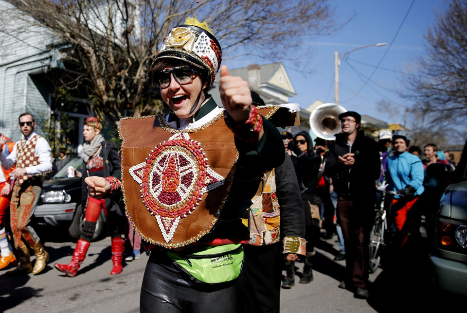 Photo - The sixth annual Red Beans Parade rolled through the Marigny and ended in the Treme with The Treme Brass Band on Lundi Gras, Monday, March 3, 2014, in New Orleans. Participants sported costumes made of various kinds of beans. (AP Photo/NOLA.com The Times-Picayune, Kathleen Flynn) MAGS OUT; NO SALES; USA TODAY OUT; THE BATON ROUGE ADVOCATE OUT