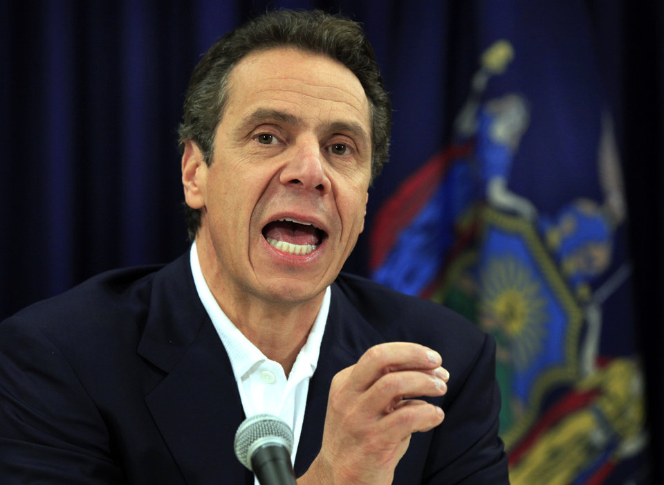 Photo -  FILE - In this Nov. 8, 2012 file photo, New York Gov. Andrew Cuomo talks about storm damage at a news conference in New York. For Cuomo, leadership after Superstorm Sandy came with an angry tirade at utilities slow to restore power. For New York City Mayor Michael Bloomberg, it came with cool, businesslike assurance. For New Jersey Gov. Chris Christie, it often came with an empathetic hug. (AP Photo/Richard Drew, File)
