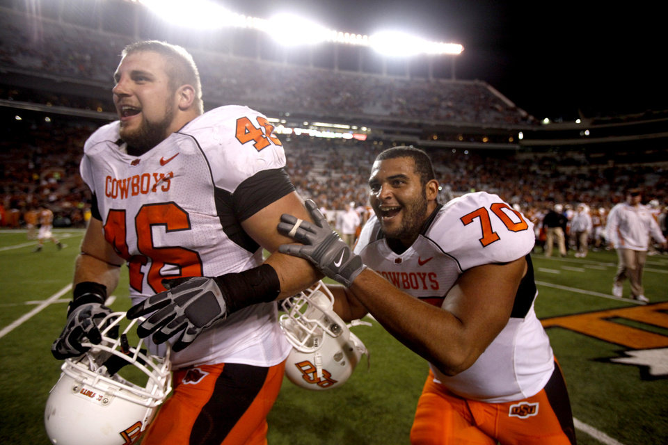 Photo - Oklahoma State's Shane Jarka (46) and Oklahoma State's Jonathan Rush (70) celebrate the Cowboys' win over Texas at Darrell K Royal-Texas Memorial Stadium in Austin, Texas, Saturday, November 13, 2010. Photo by Sarah Phipps, The Oklahoman