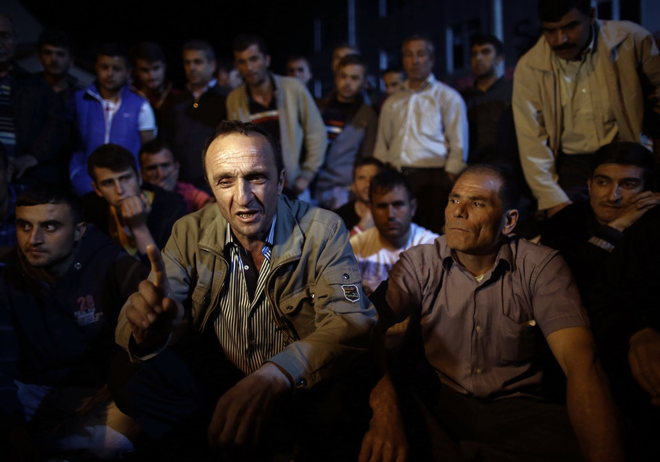 Photo - Miner Cetin Esmer speaks to the Associated Press as he joined fellow miners and their children to commemorate the Soma mine accident victims and protest the government's labor policy in Savastepe , Turkey, late Friday, May 16, 2014. A Turkish mining company defended its safety record Friday, four days after over 250 people died in an underground blaze at its coal mine in western Turkey.(AP Photo/Emrah Gurel)