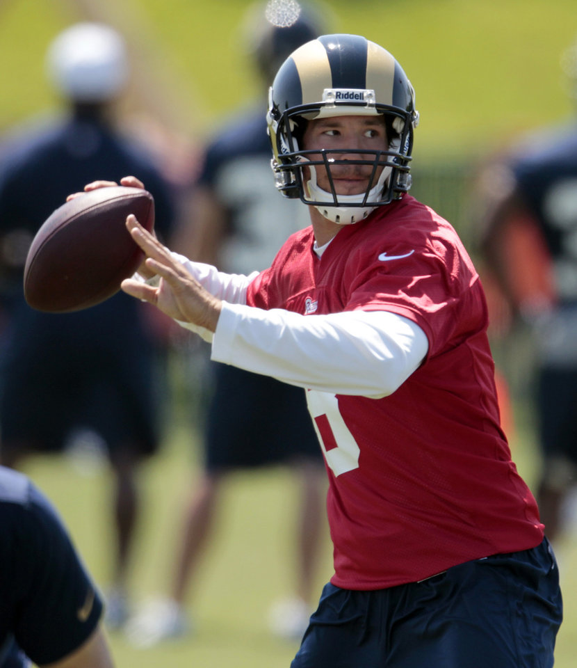 Photo -   St. Louis Rams quarterback Sam Bradford throws during NFL football practice, Wednesday, May 16, 2012, at the team's training facility in St. Louis. (AP Photo/Jeff Roberson)