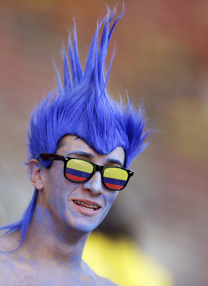 Photo - A Colombia fan waits for the group C World Cup soccer match between Colombia and Ivory Coast at the Estadio Nacional in Brasilia, Brazil, Thursday, June 19, 2014.  (AP Photo/Themba Hadebe)