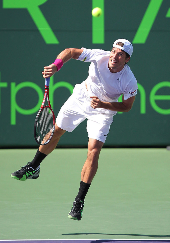 Tommy Haas, of Germany, serves the ball to David Ferrer, of Spain, during a semifinal at the Sony Open tennis tournament, Friday, March 29, 2013, in Key Biscayne, Fla. Ferrer won 4-6, 6-2, 6-3. (AP Photo/El Nuevo Herald, David Santiago) MAGS OUT