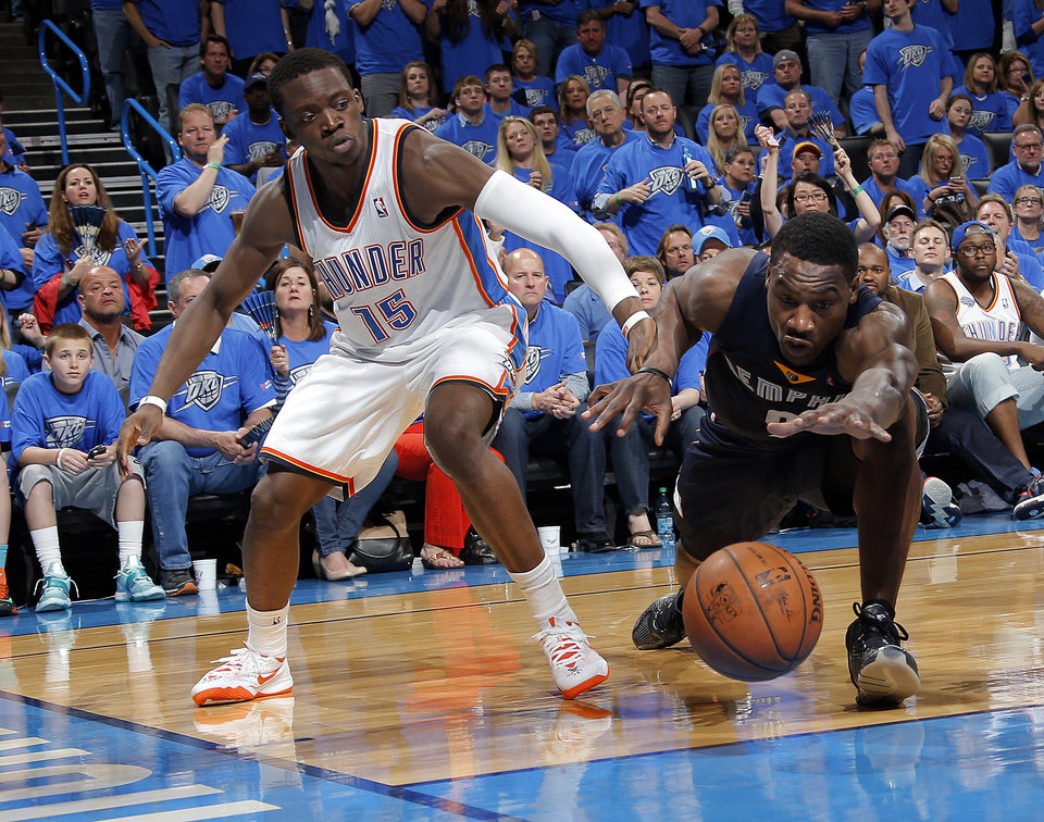 Photo - Memphis' Tony Allen (9) dives for a loose ball in front of Oklahoma City's Reggie Jackson (15) during Game 1 in the first round of the NBA playoffs between the Oklahoma City Thunder and the Memphis Grizzlies at Chesapeake Energy Arena in Oklahoma City, Saturday, April 19, 2014. Photo by Sarah Phipps, The Oklahoman