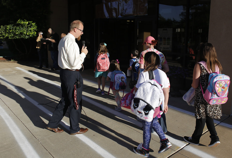 School Leaders Bring Enthusiasm To First Day Of Classes In