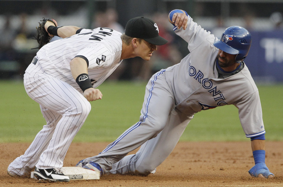 Photo -   Chicago White Sox second baseman Gordon Beckham, left, tags out Toronto Blue Jays' Jose Bautista during the first inning of a baseball game in Chicago, Friday, July 6, 2012. (AP Photo/Nam Y. Huh)