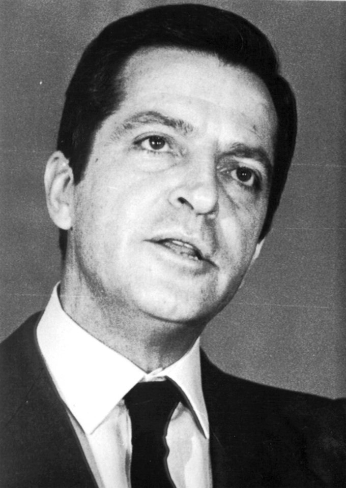 Photo - FILE - This is a 1980 file photo of former Prime Minister of Spain  Adolfo Suarez. Suarez  Spain's first democratically-elected prime minister after decades of right-wing rule under Gen. Francisco Franco, died Sunday March 23, 2014. Suarez was 81-years-old. (AP-Photo/File)