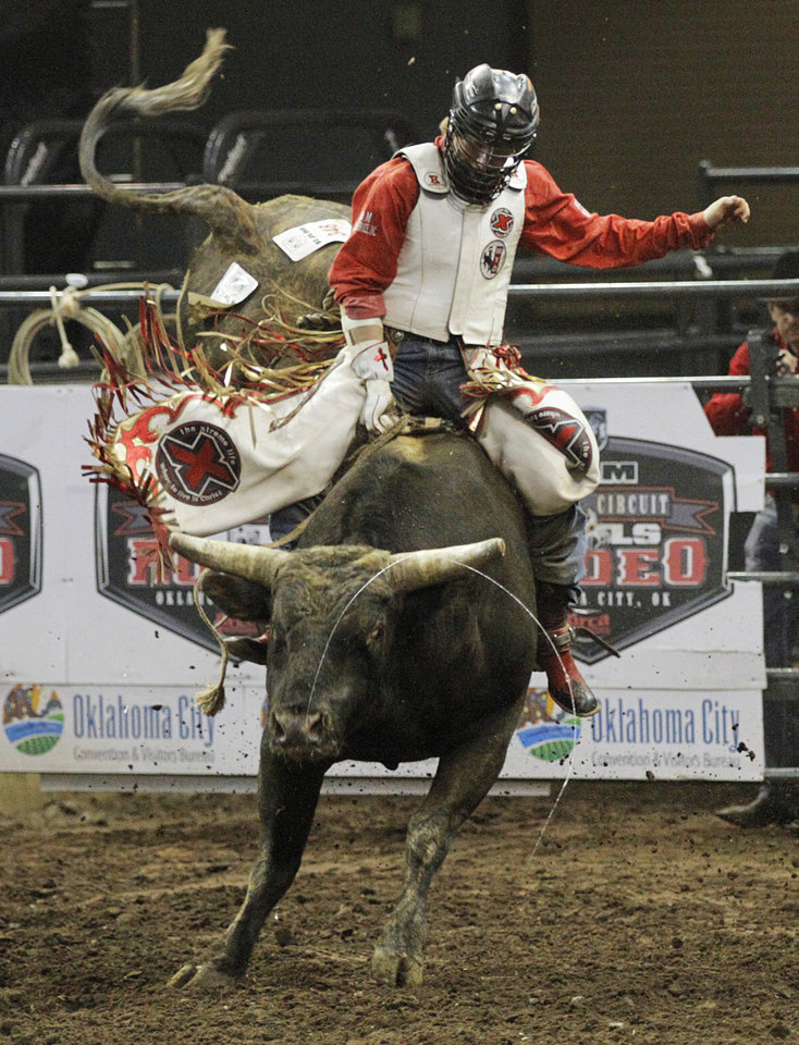 Bobby Welsh, of Gillette, Wyo., competes in bull riding during the Ram National Circuit Finals Rodeo Championship in Oklahoma City, Sunday, April 1, 2012.  Photo by Garett Fisbeck, For The Oklahoman