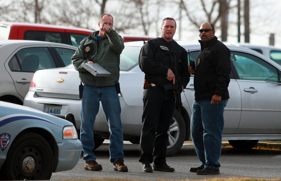 Photo - Law enforcement officers talk at the scene of a reported homicide at Casper College on Friday morning, Nov. 30, 2012, in Casper, Wyo. At least one person was killed and another was wounded Friday in an attack at Casper College, a community college in central Wyoming. It happened around 9 a.m., said school spokesman Rich Fujita.  (AP Photo/Casper Star-Tribune, Alan Rogers) MANDATORY CREDIT  TRIB.COM