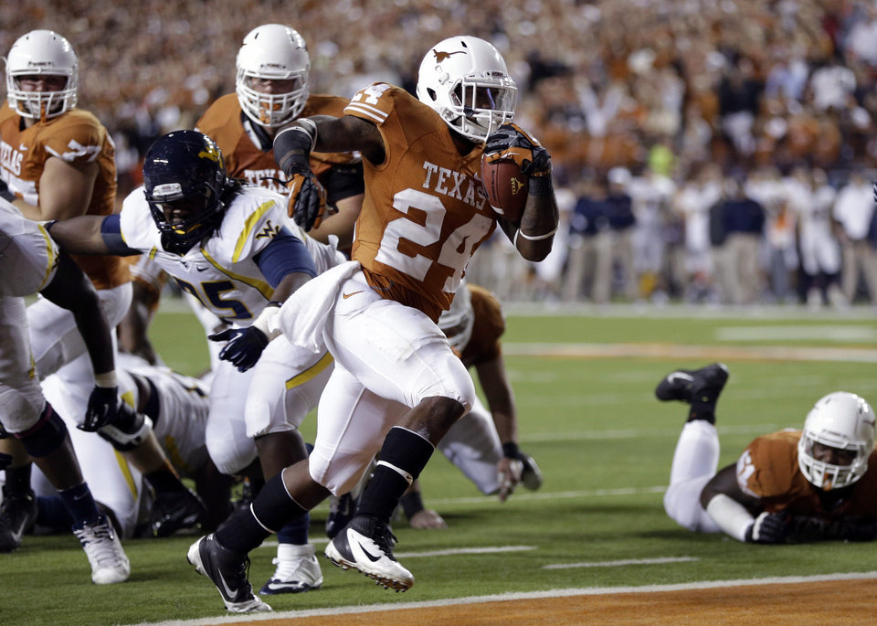 Texas\' Joe Bergeron (24) scores against West Virginia during the third quarter of an NCAA college football game on Saturday, Oct. 6, 2012, in Austin, Texas. (AP Photo/Eric Gay)