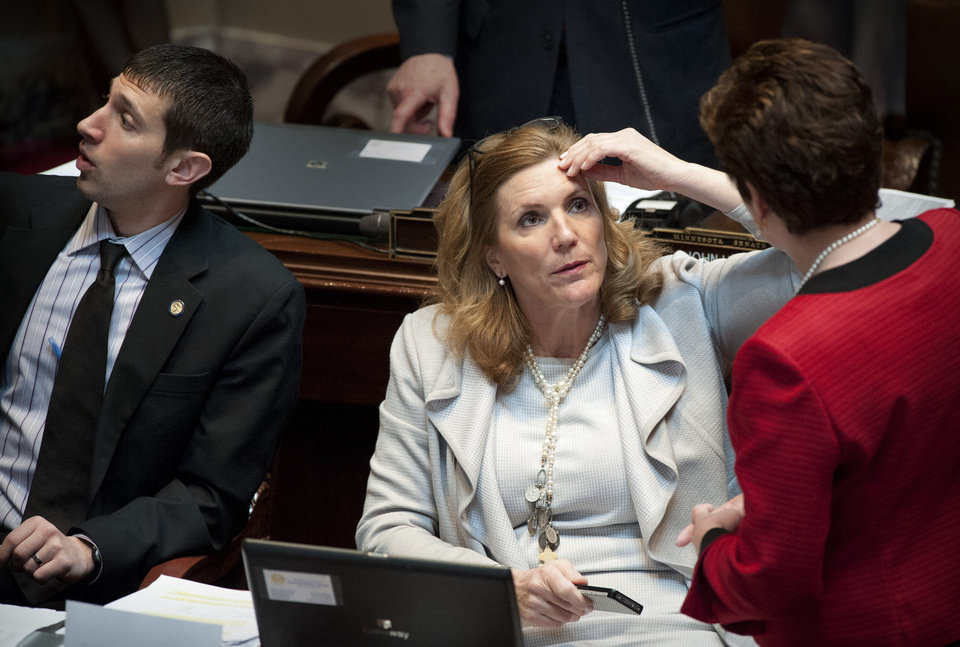 Sen. Julie Rosen, seated, sponsor of the Minnesota Vikings stadium bill, talks with Sen. Carla Nelson before debate on Rosen\'s bill Tuesday, May 8, 2012, in St. Paul, Minn. (AP Photo/Star Tribune, Glen Stubbe) ST. PAUL OUT MINNEAPOLIS-AREA TV OUT MAGS OUT