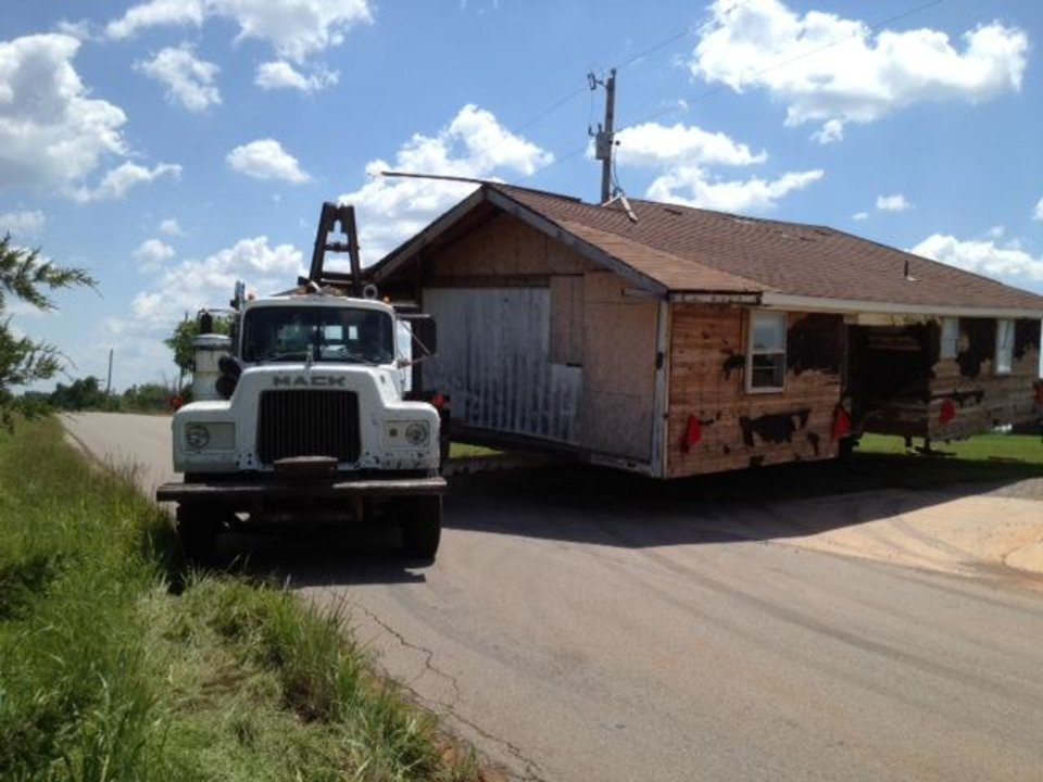 Photo - 36th ave blocked by  broken down  truck moving a house in Norman. Photo by Steve Sisney.