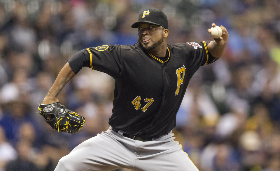 Photo - Pittsburgh Pirates' Francisco Liriano pitches to Milwaukee Brewers' Carlos Gomez during the first inning of a baseball game on Friday, April 11, 2014, in Milwaukee. (AP Photo/Tom Lynn)