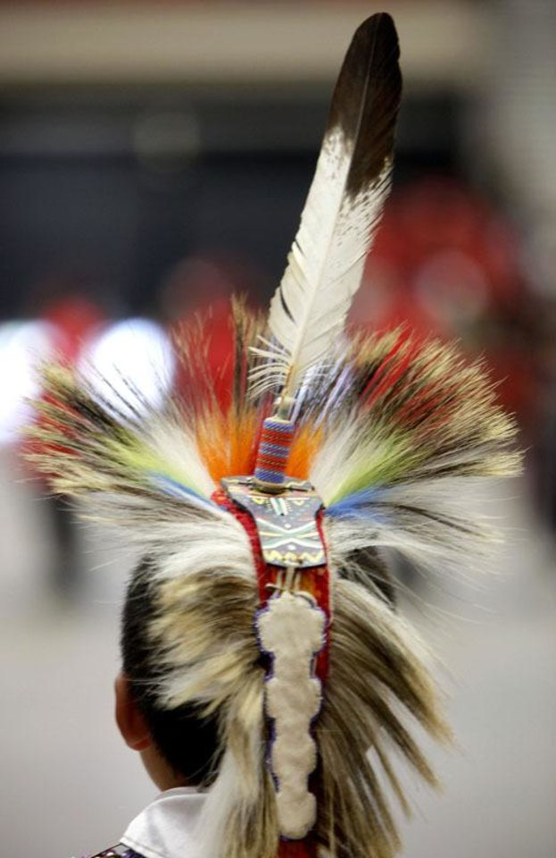 Photo - Oklahoma has the fourth largest Indian population in the nation.  In this picture a participant dances during the grand entry at the Red Earth Festival at the Cox Convention Center in Oklahoma CIty, Sunday, June 20, 2010. Photo by Sarah Phipps, The Oklahoman