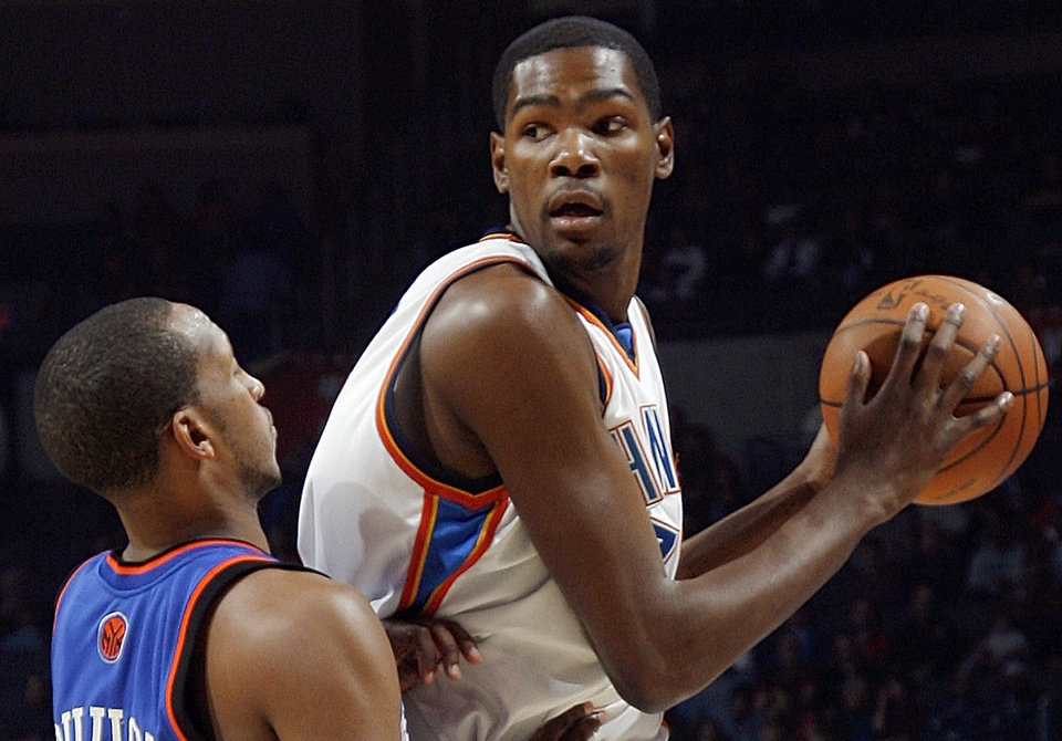 Oklahoma City's Kevin Durant looks to get the ball past New York's Chris Duhon during the Thunder's 106-88 win Monday. PHOTO BY NATE BILLINGS, THE OKLAHOMAN