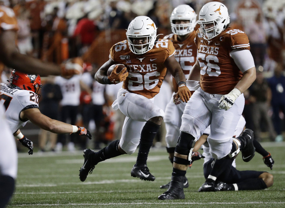 Photo - Texas running back Keaontay Ingram (26) carries against Oklahoma State during the second half of an NCAA college football game Saturday, Sept. 21, 2019, in Austin, Texas. (AP Photo/Eric Gay)