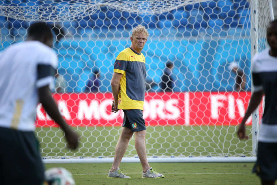 Photo - Cameroon coach Volker Finke walks on the pitch during a training session at the Arena das Dunas in Natal, Brazil, Thursday, June 12, 2014. Cameroon will play in group A in the Brazil 2014 soccer World Cup. (AP Photo/Sergei Grits)