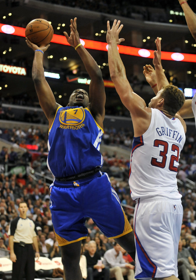 Los Angeles Clippers forward Blake Griffin, right, defends as Golden State Warriors forward Carl Landry (7) drives to the basket in the first half of an NBA basketball game in Los Angeles on Saturday, Nov. 3, 2012. (AP Photo/Richard Hartog) ,