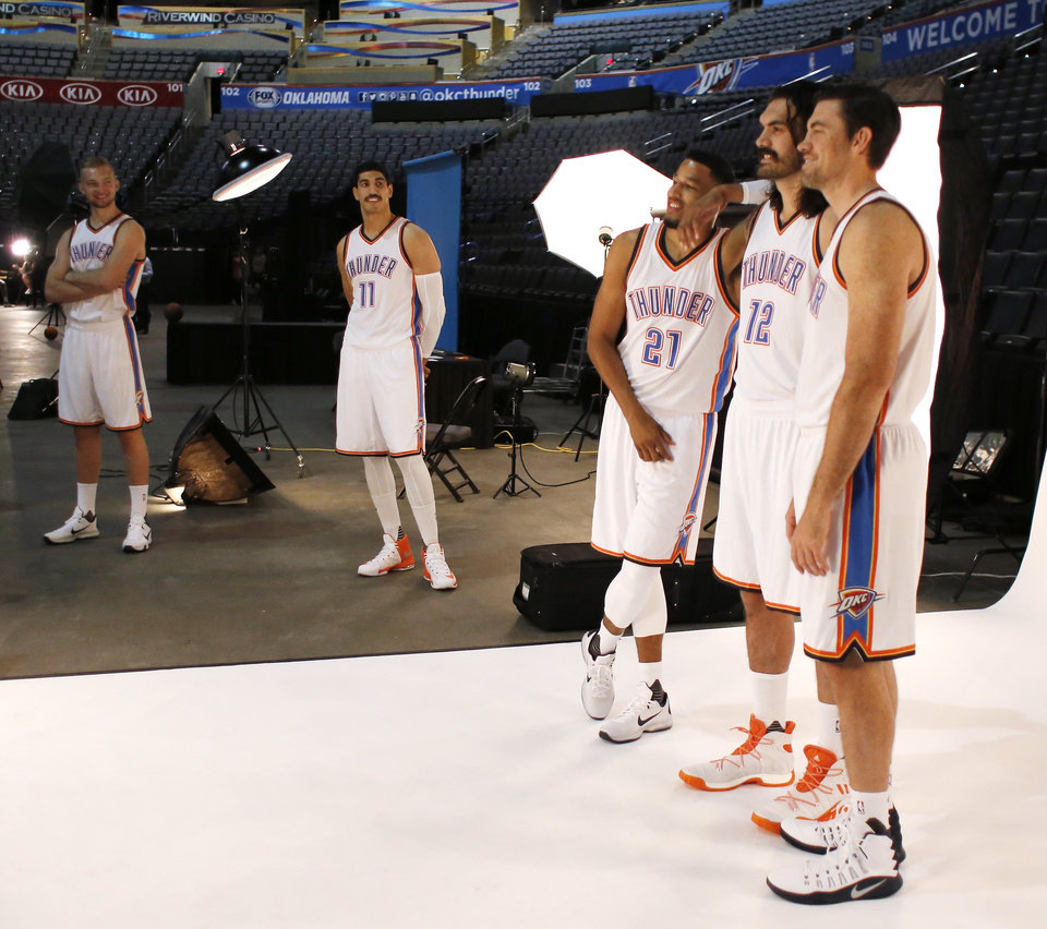 Photo - Domantas Sabonis and Enes Kanter watch as Andre Roberson, Steven Adams and Nick Collison pose for a photo during the Oklahoma City Thunder media day, Friday, September 23, 2016. Photo by Doug Hoke, The Oklahoman