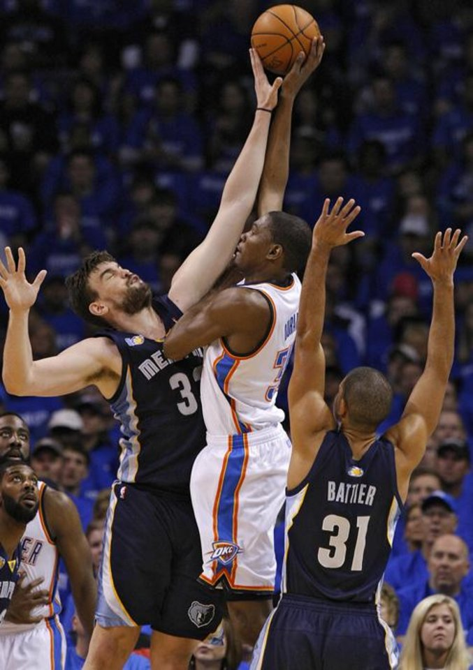 Photo -  Memphis' Marc Gasol (33) blocks a shot by Oklahoma City's Kevin Durant (35) during game one of the Western Conference semifinals between the Memphis Grizzlies and the Oklahoma City Thunder in the NBA basketball playoffs at Oklahoma City Arena in Oklahoma City, Sunday, May 1, 2011. Photo by Chris Landsberger, The Oklahoman ORG XMIT: KOD