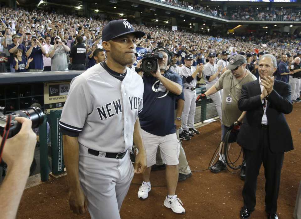 Photo - New York Yankees relief pitcher Mariano Rivera takes the field for a retirement presentation before the baseball game against the Houston Astros Sunday, Sept. 29, 2013, in Houston. (AP Photo/Richard Carson)