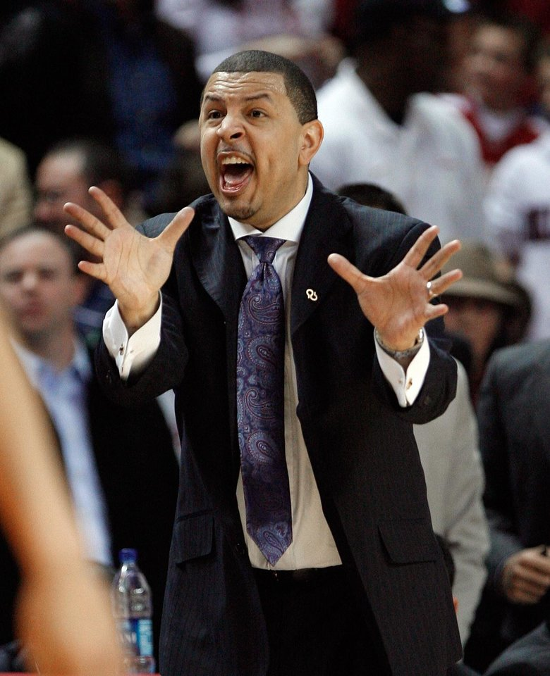 Photo - Head coach Jeff Capel shouts to his defense during the second half of the college bedlam basketball game in which The University of Oklahoma Sooners (OU) defeated Oklahoma State University University Cowboys (OSU) 62-57 in overtime at the Lloyd Noble Center on Monday, Jan. 11, 2010, in Norman, Okla.