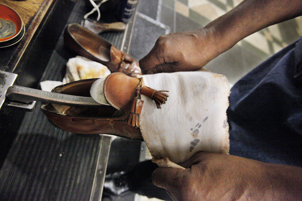 Cleo Fields, with Cleo\'s Professional Shine, working on shoes dropped off at his shoe shine booth on the ground floor of the Oklahoma County Courthouse in Oklahoma City Friday, March 16, 2912. Photo by Paul B. Southerland, The Oklahoman