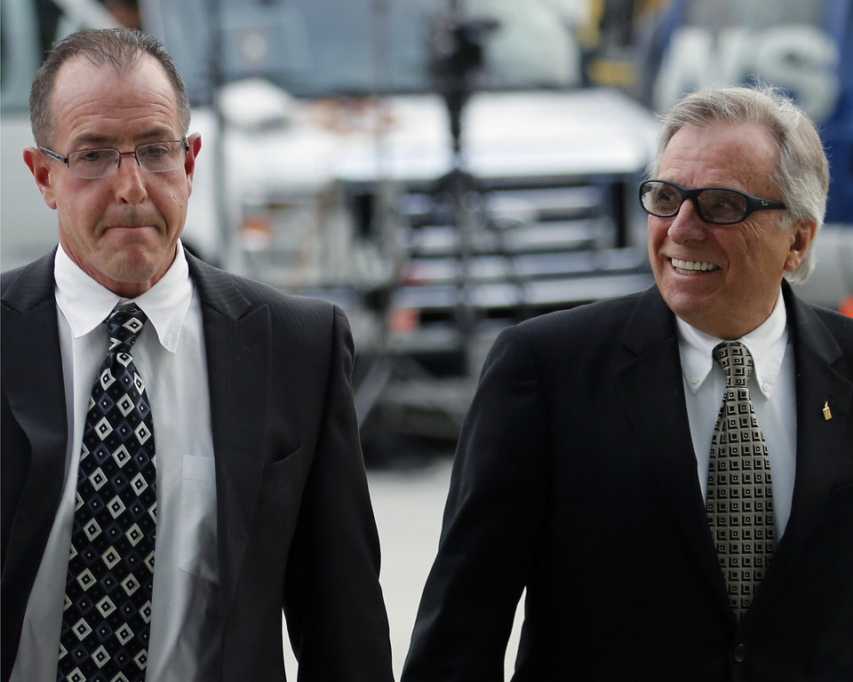 Photo - Michael Lohan,father of actress Lindsay Lohan, left, arrives with minister Marty Angelo, president for Once Life Matters Ministries, at the Los Angeles Superior court on Monday, March 18, 2013. Lindsey Lohan is charged with three misdemeanor counts stemming from a crash on Pacific Coast Highway. She is charged with willfully resisting, obstructing or delaying an officer, providing false information to an officer and reckless driving. She is also accused of violating her probation in a misdemeanor jewelry theft case. (AP Photo/Damian Dovarganes)