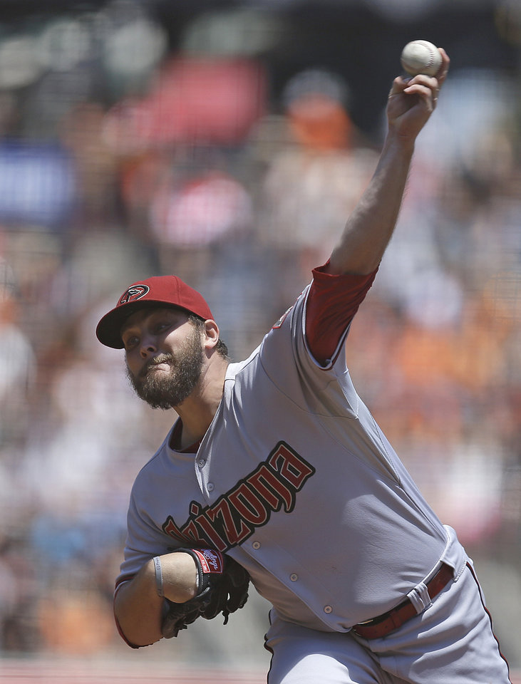 Photo - Arizona Diamondbacks' Wade Miley works against the San Francisco Giants in the first inning of a baseball game Saturday, July 12, 2014, in San Francisco. (AP Photo/Ben Margot)