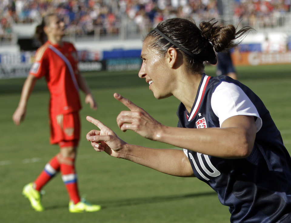 Photo - United State's Carli Lloyd (10) celebrates after scoring against Russia during an international friendly soccer match in Boca Raton, Fla., Saturday, Feb. 8, 2014. The U.S won 7-0. (AP Photo/Alan Diaz)