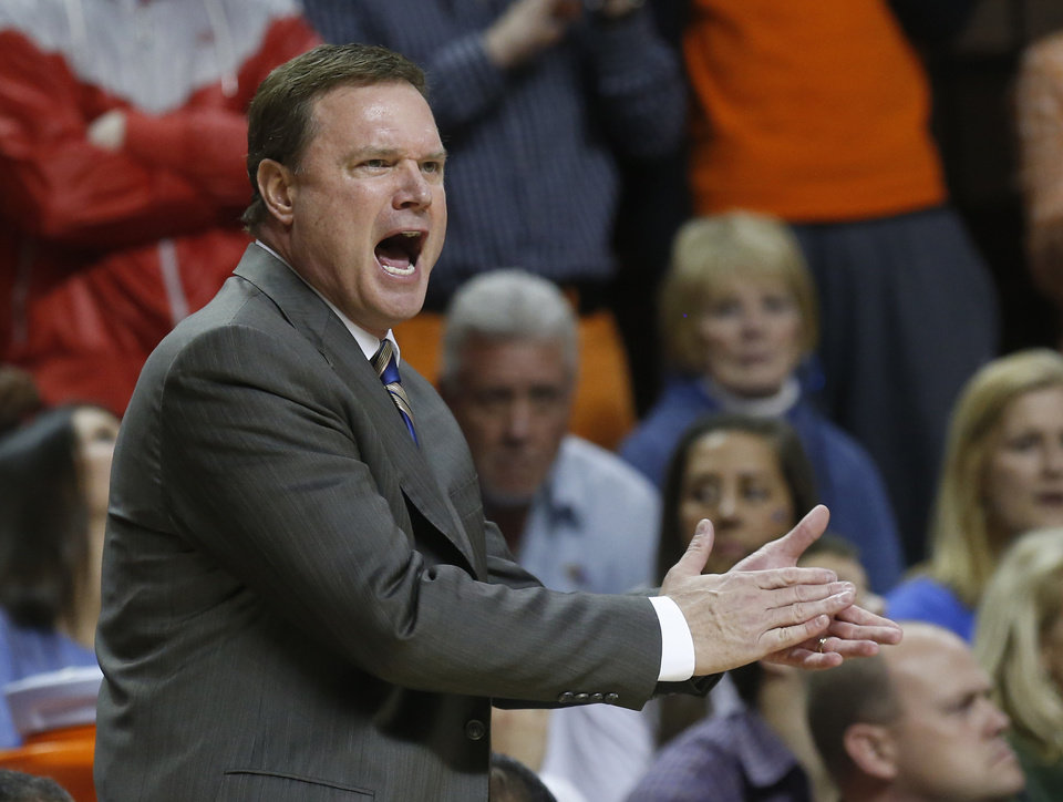 Photo - Kansas head coach Bill Self shouts during the first half of an NCAA college basketball game against Oklahoma State in Stillwater, Okla., Wednesday, Feb. 20, 2013. (AP Photo/Sue Ogrocki)