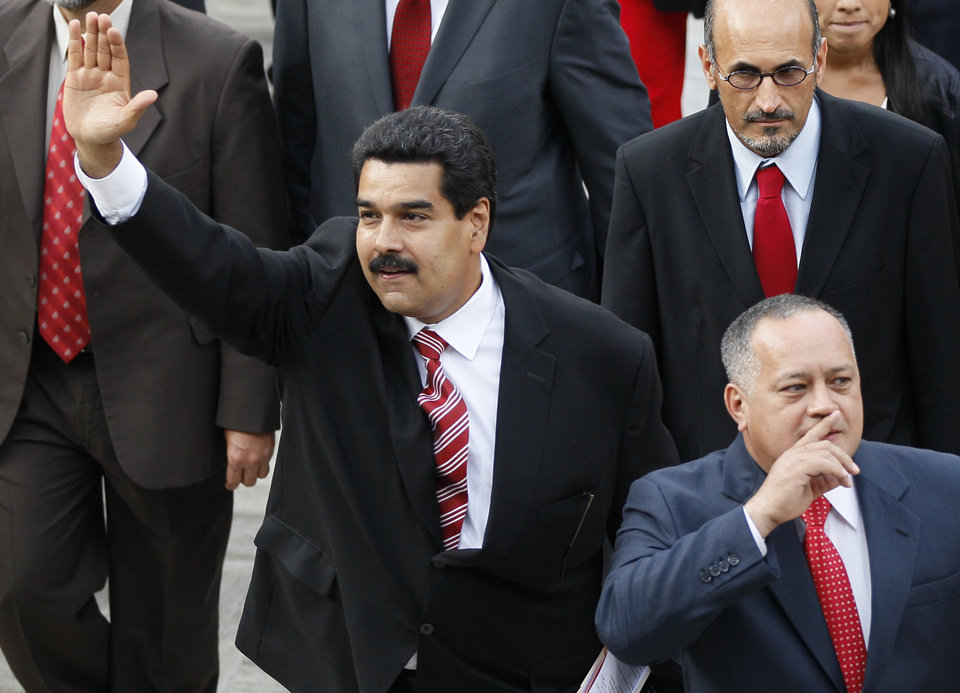 Photo - Venezuela's Vice President Nicolas Maduro, left, and Diosdado Cabello, president of Venezuela's National Assembly, gesture to supporters as they arrive to the National Assembly for the state-of-the-nation address in Caracas, Venezuela, Thursday, Feb. 28, 2013.  Maduro, Chavez's self-appointed successor, said on television that his boss