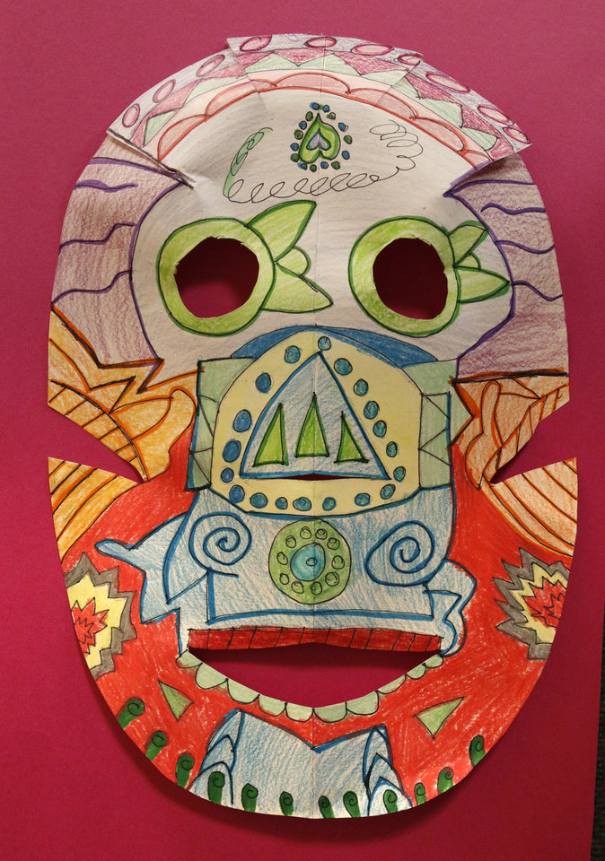 Photo - This piece by Britton Elementary student  Anna E., from Ms. Alison Harris' fourth-grade class, is part of a student art exhibit commemorating Day of the Dead on display at the Plaza Mayor Fall Festival in Oklahoma City. Photo by Paul Hellstern, The Oklahoman  PAUL HELLSTERN