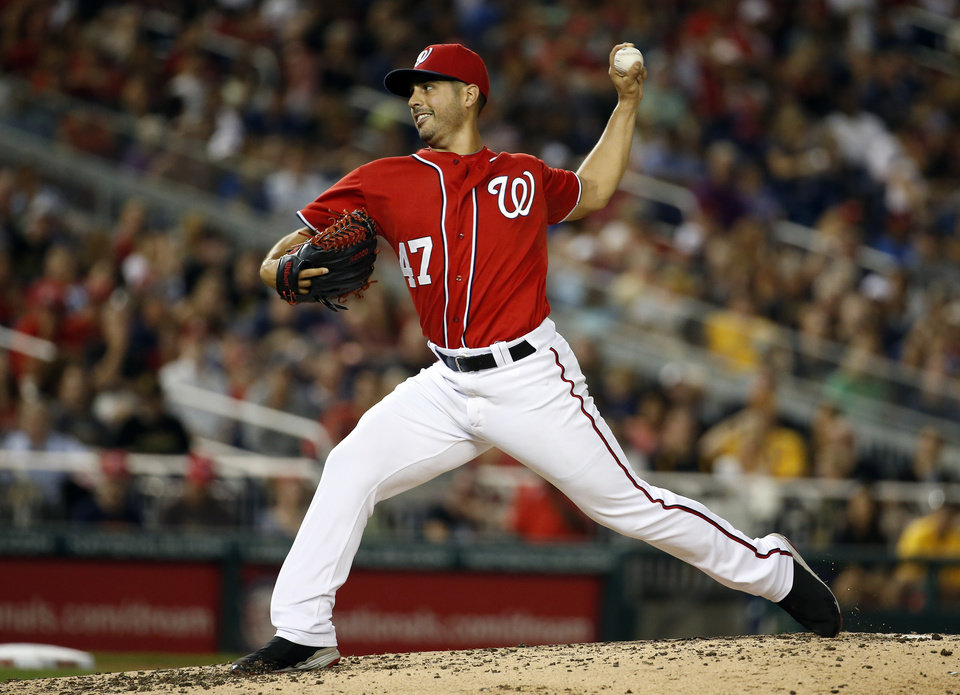 Photo - Washington Nationals starting pitcher Gio Gonzalez throws during the fourth inning of a baseball game against the Pittsburgh Pirates at Nationals Park, Saturday, Aug. 16, 2014, in Washington. (AP Photo/Alex Brandon)