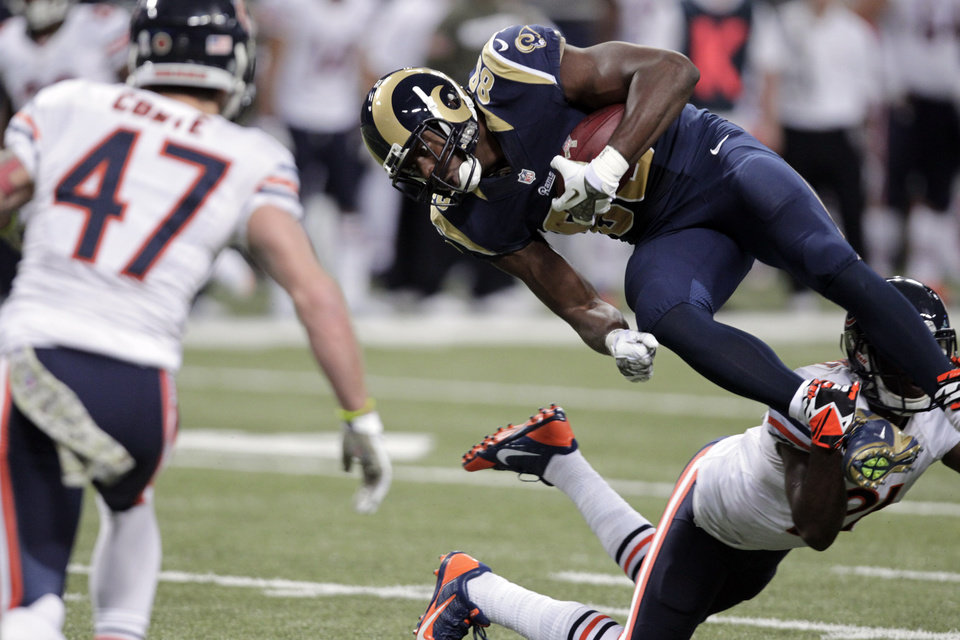 Photo - St. Louis Rams tight end Jared Cook, top right, is upended by Chicago Bears safety Major Wright, bottom right, as Bears safety Chris Conte (47) watches after Cook caught a pass for a 29-yard gain during the fourth quarter of an NFL football game on Sunday, Nov. 24, 2013, in St. Louis. The Rams won 42-21. (AP Photo/Tom Gannam)
