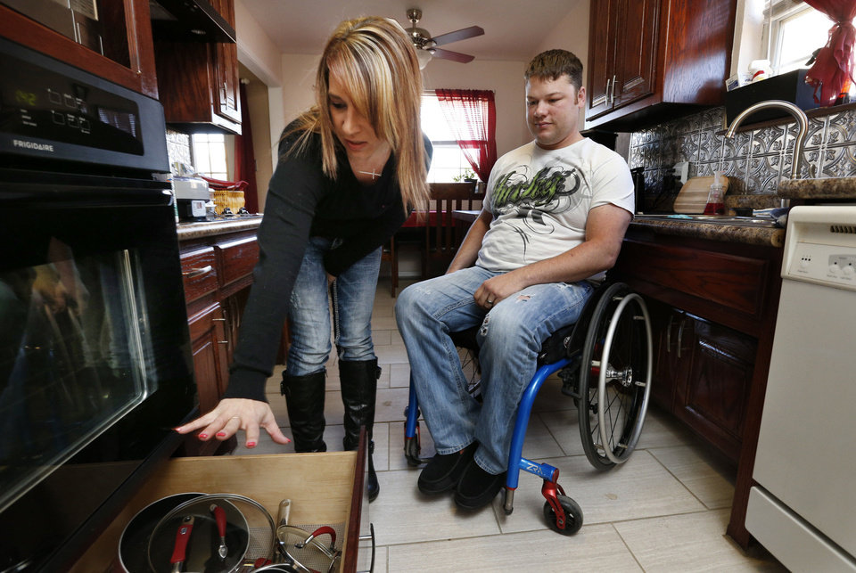 Jean Pittman and her husband, EH, show off their remodeled and handicap-accessible kitchen. The work was completed after he was injured in the May 20 Moore tornado. PHOTO STEVE SISSNEY, THE OKLAHOMAN. <strong>STEVE SISNEY - THE OKLAHOMAN</strong>