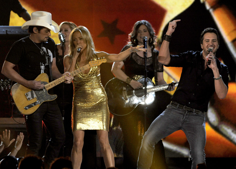 From left, musicians Brad Paisley, Cheryl Crow and Luke Bryan perform on stage at the 48th Annual Academy of Country Music Awards at the MGM Grand Garden Arena in Las Vegas on Sunday, April 7, 2013. (Photo by Chris Pizzello/Invision/AP) ORG XMIT: NVPM208