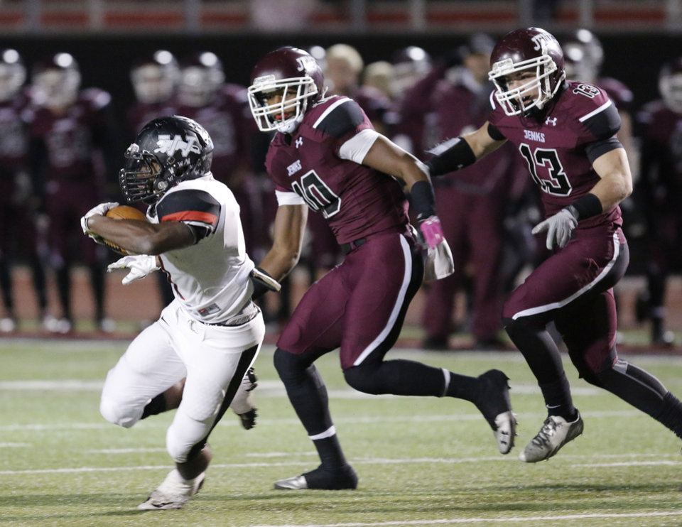 Photo - Westmoore's Kieron Hardick (1) tries to outrun Jenk's Steven Parker (10) and Chris Lily (13) during the 6A high school playoff game between Westmoore and Jenks at Yukon High School Friday November 29, 2013. Photo by Doug Hoke, The Oklahoman