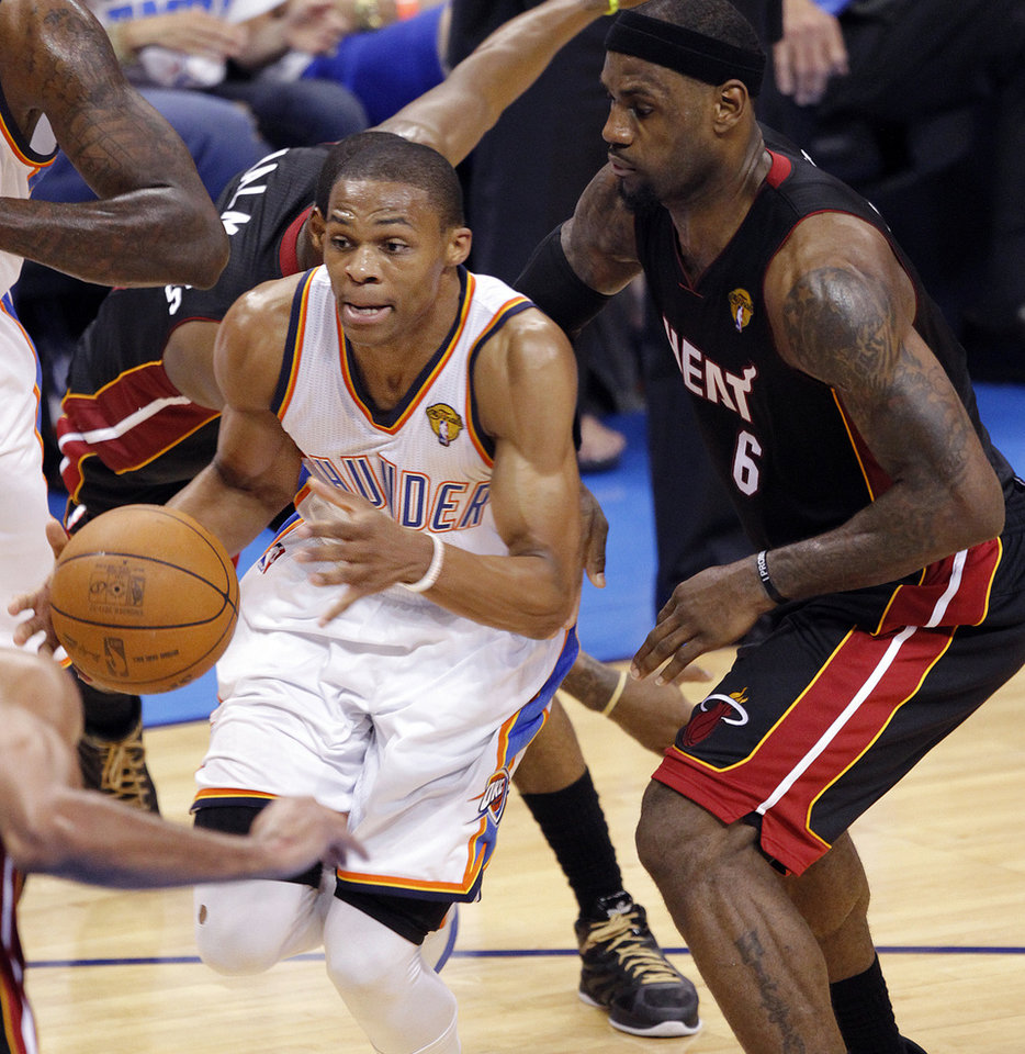 Oklahoma City's Russell Westbrook (0) drives past Miami's LeBron James (6) during Game 2 of the NBA Finals between the Oklahoma City Thunder and the Miami Heat at Chesapeake Energy Arena in Oklahoma City, Thursday, June 14, 2012. Photo by Chris Landsberger, The Oklahoman