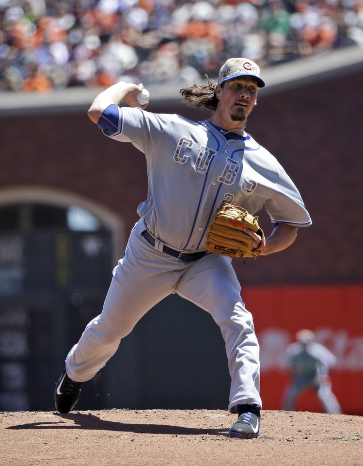 Photo - Chicago Cubs starting pitcher Jeff Samardzija throws to the San Francisco Giants during the first inning of a baseball game on Monday, May 26, 2014, in San Francisco. (AP Photo/Marcio Jose Sanchez)
