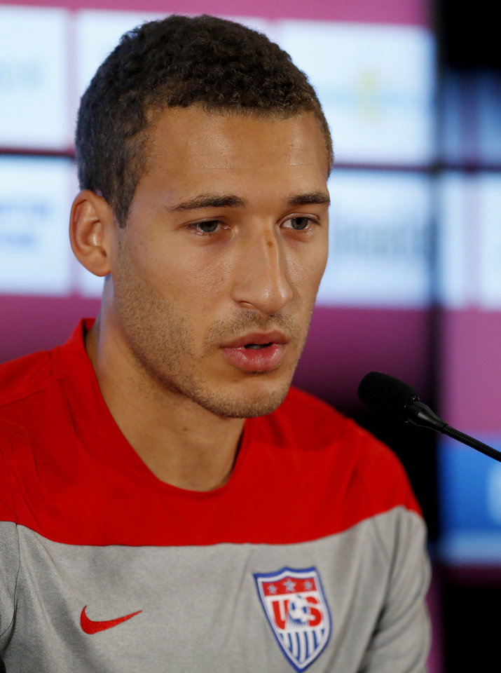 Photo - United States' Fabian Johnson talks during a press conference before a training session in Sao Paulo, Brazil, Thursday, June 19, 2014.  The United States will play against Portugal in group G of the 2014 soccer World Cup on June 22. (AP Photo/Julio Cortez)