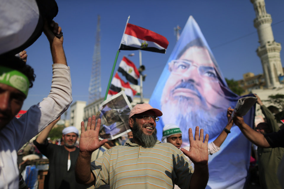 Supporters of ousted Egypt's Islamist President Mohammed Morsi chant slogans during a rally, in Nasser City, Cairo, Egypt, Thursday, July 4, 2013. The chief justice of Egypt's Supreme Constitutional Court was sworn in Thursday as the nation's interim president, taking over hours after the military ousted the Islamist President Mohammed Morsi. Adly Mansour took the oath of office at the Nile-side Constitutional Court in a ceremony broadcast live on state television. According to military decree, Mansour will serve as Egypt's interim leader until a new president is elected. A date for that vote has yet to be set. (AP Photo/Hassan Ammar)