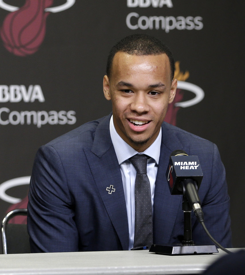 Photo - Miami Heat's Shabazz Napier smiles as he answers a question during a news conference in Miami, Monday, June 30, 2014. The Heat acquired the draft rights to Connecticut guard Shabazz Napier in a trade with the Charlotte Hornets on Thursday night, giving up the 26th and 55th picks to make the deal happen, along with a future second-round choice and cash considerations.  (AP Photo/Alan Diaz)